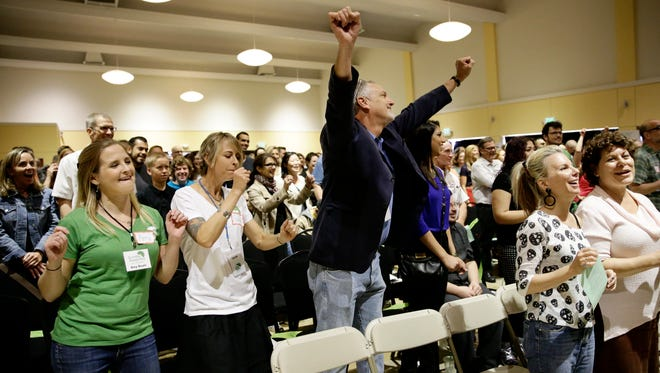 Attendees sing a song at the Sunday Assembly, a godless congregation founded by British comedians Sanderson Jones and Pippa Evans, on Sunday in Los Angeles.
