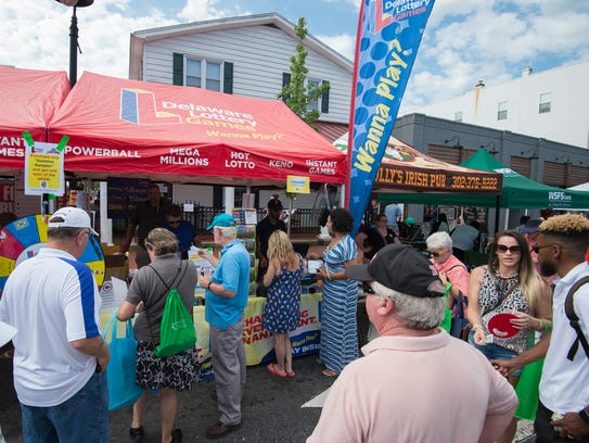 Festivalgoers line up to buy Powerball lottery tickets