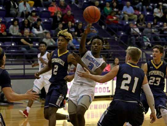 Hirschi's Mark Harrell passes while guarded by Stephenville's