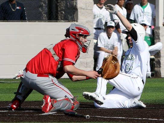 Iowa Park's Kaden Ashlock slides into home to score