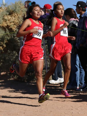 Shiprock's Lacey Howe and Khadija Lapahie run side by side at the girls 4A state cross-country championship meet in Albuquerque.