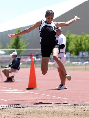 Navajo Prep's Monty Larvingo competes in the triple jump at the 1-A/3A state track and field championship meet on Saturday in Albuquerque.