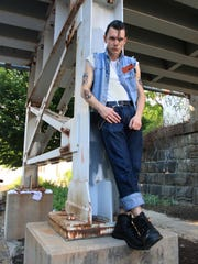 Joey Napolizzi wears Levi jeans; T-shirt; distressed denim vest made from his mom's biker jacket; black leather Redwing boots.
