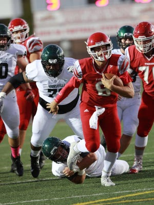 Fishers QB Max Wolff breaks loose from Zionsville defender in the Tigers' win over the Eagles Friday night.