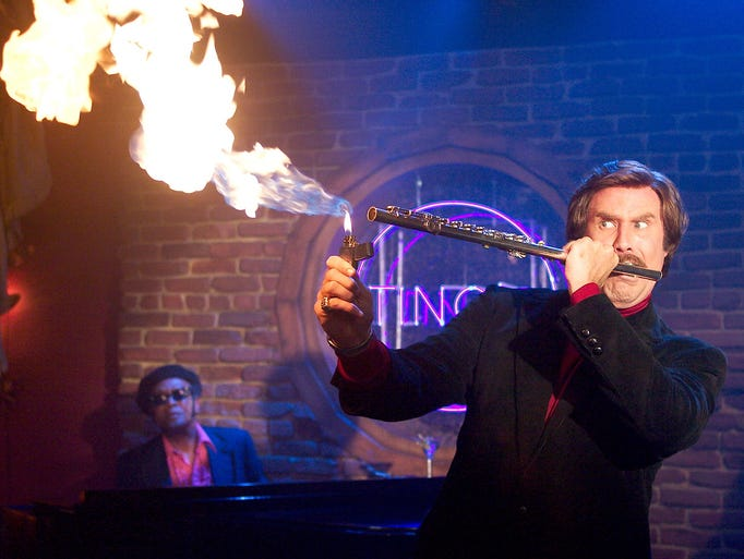 Ron (Will Ferrell) ignites his flute during an impromptu jazz performance in one of the most memorable scenes in 'Anchorman: The Legend of Ron Burgundy.'