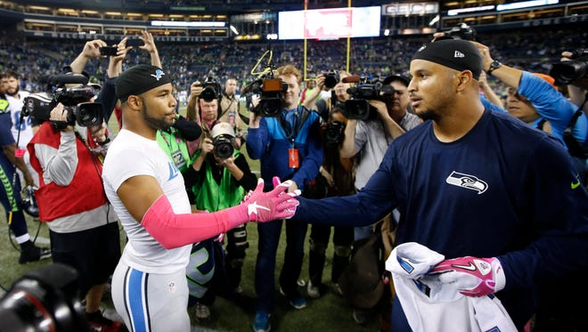 Oct 5, 2015; Seattle, WA, USA; Lions receiver Golden Tate exchanges jerseys with Seahawks receiver Jermaine Kearse following a 13-10 Seattle victory at CenturyLink Field.