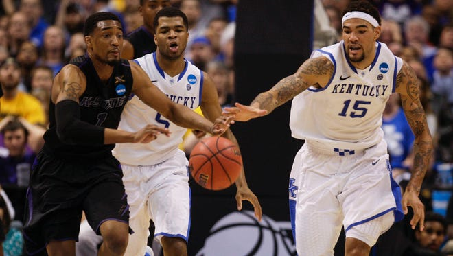 Kentucky's Willie Cauley-Stein battled K-State's Shane Southwell for a loose ball in the NCAA tournament Midwest second round in St. Louis, Mo. March 21, 2014