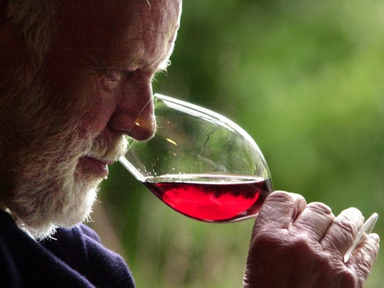 David Lett savors the bouquet from a glass of Pinot Noir at his Eyrie Vinyards home in Dundee in 2004. Lett died in 2008 of heart failure and passed the business on to his son, Jason.