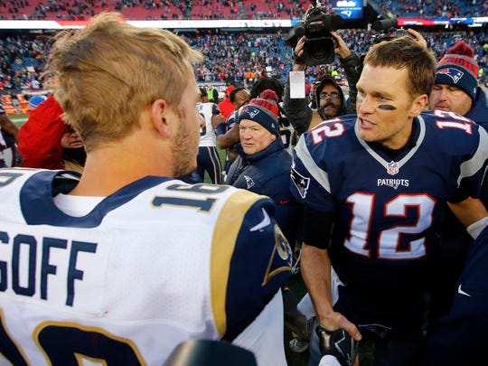Dec 4, 2016; Foxborough, MA, USA; New England Patriots quarterback Tom Brady (12) is congratulated by Los Angeles Rams quarterback Jared Goff (16) after his 201st career win becoming the all-time leader at Gillette Stadium. The Patriots won 26-10.Mandatory Credit: Winslow Townson-USA TODAY Sports