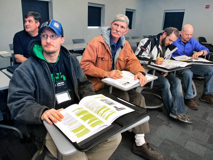 Mike DeVuono, Kingston, Tenn., left, and Carroll Stone, Fayettesville, N.C., take a truck driving class at Celadon trucking company's drivers school on Friday, February 14, 2014. The school, which moved to a new building on the northeast corner of Post Road and East 33rd Street, in mid-January, helps students attain Class A commercial driver's licenses (CDL) in about a month.