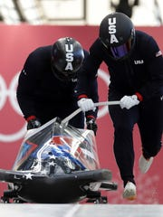 Driver Nick Cunningham and Hakeem Abdul-Saboor of the