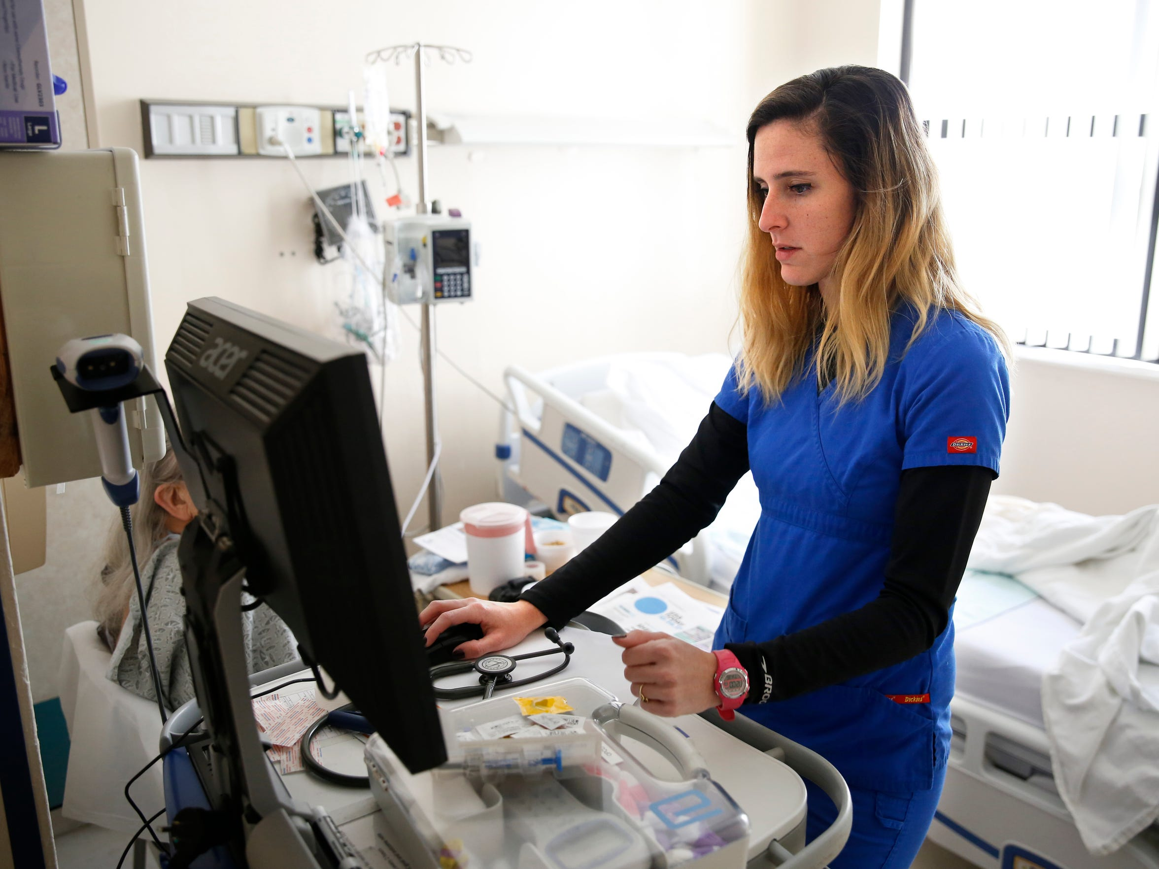 Registered nurse and TCC runner Ashley Maxwell visits a patient in the Cardiac Progressive Care Unit at TMH Oct 26.