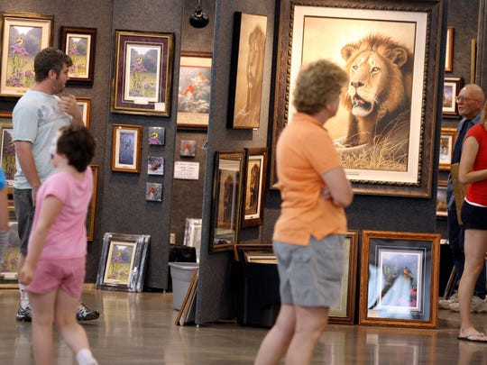 A crowd filters into a previous year's Artfest Midwest event in the Knapp Varied Industries Building at the Iowa State Fairgrounds.