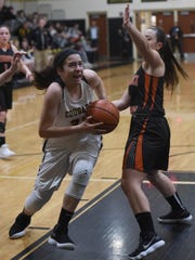 Cresskill's Colleen McQuillen (33) drives to the basket