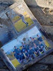 family photos in mudslide debris