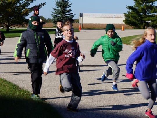 People of all ages run to raise money for Shepherd of the Hills' tuition assistance fund as part of the Run for the Hills.