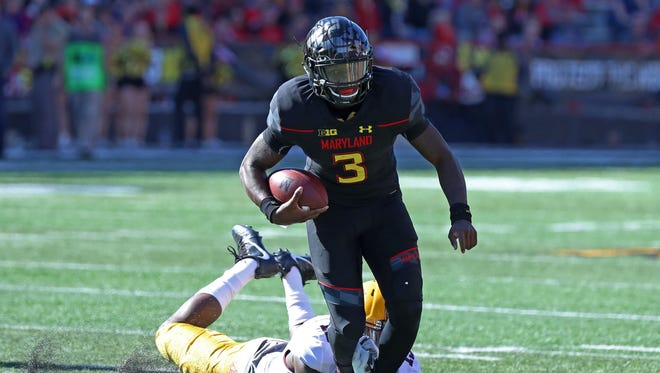 Maryland Terrapins quarterback Tyrrell Pigrome (3) runs against the Minnesota Golden Gophers at Byrd Stadium.