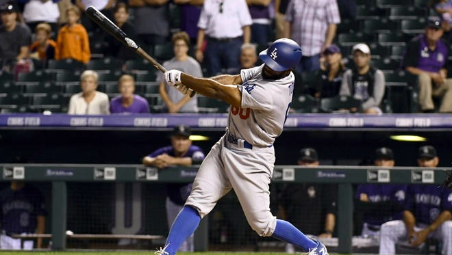 Los Angeles Dodgers right fielder Andrew Toles hits a grand slam in the ninth inning against the Colorado Rockies.