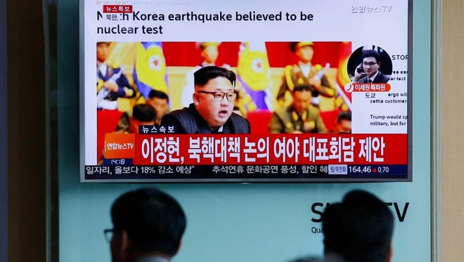 South Koreans watch a television news broadcast at a train station in Seoul on Sept. 9, 2016 . The broadcast shows North Korean leader Kim Jong Un.