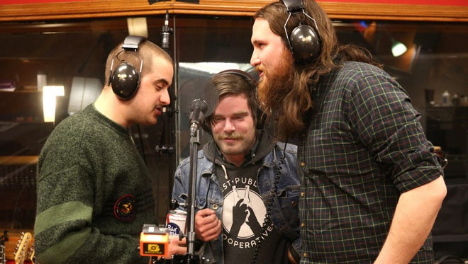 """Zach Otto (from left), Harrison Colby and Conner La Mue of the band Sex Scenes record vocals for the """"Unpresidented"""" recording session at Howl Street Recordings on April 21."""