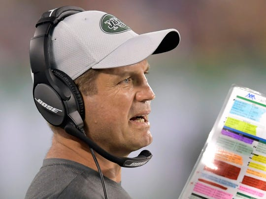FILE - In this Aug. 10, 2018, file photo, New York Jets offensive coordinator Jeremy Bates looks on during the first half of a preseason NFL football game against the Atlanta Falcons in East Rutherford, N.J. Bates says the team has experienced malfunctions in its sideline headsets in each of its three games this season.  (AP Photo/Bill Kostroun, File)
