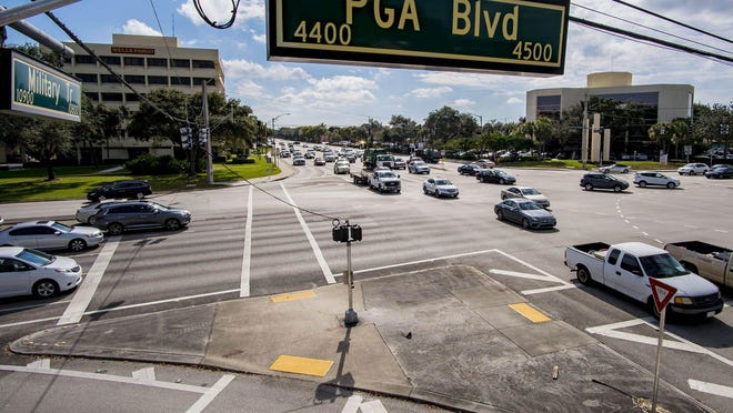 Cars cross the intersection at the corner of PGA Boulevard and Military Trail in Palm Beach Gardens Wednesday.