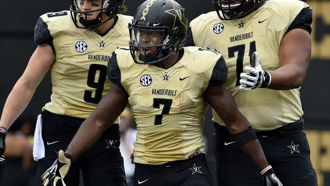 Vanderbilt running back Ralph Webb (7) reacts to scoring a touchdown against Western Kentucky during the first half at Vanderbilt Stadium in Nashville, Tenn., Saturday, Nov. 4, 2017.