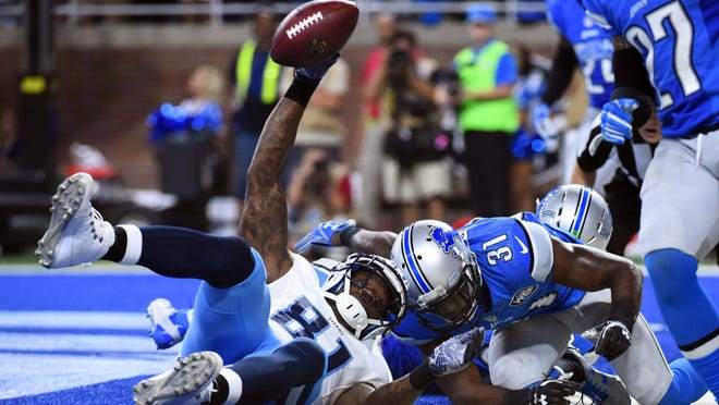 Titans wide receiver Andre Johnson (81) scores the game winning touchdown during the fourth quarter Sunday.