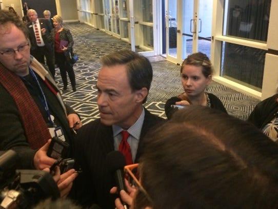 Texas House Speaker Joe Straus speaks with reporters