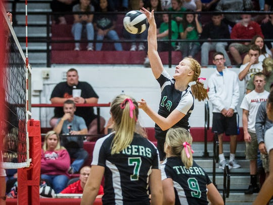 Yorktown's Tegan Syring hits against Delta during their game at Wapahani High School Saturday, Oct. 1, 2016.