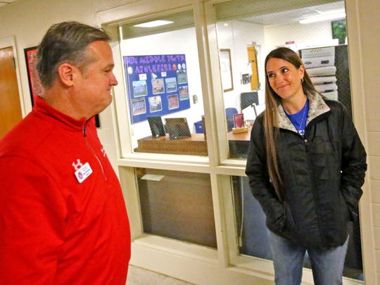 Jennifer Burnam, right, talks with John Wooden Middle School principal Eric Bowlen, Thursday, Jan. 18, 2018.  Burnam's son, Gunner Burnam, died in 2017 from a rare brain cancer DIPG.  He is being honored posthumously in a scout ceremony after his family, school, and community finished his Eagle Scout project of collecting food items to feed hungry families.  Gunner was diagnosed in Dec. 2016 and died in Sept. 2017.  Gunner is an inspiration to many, including his family and principal.