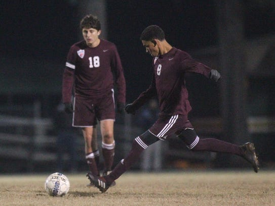 Chiles' Will Johnson takes a free kick during a 3-3