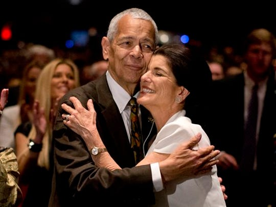 "FILE- In this April 10, 2014, file photo, social activist Julian Bond hugs Luci Baines Johnson, the younger daughter of President Lyndon Baines Johnson after singing ""We Shall Overcome"" during the Civil Rights Summit to commemorate the 50th anniversary of the signing of the Civil Rights Act in Austin, Texas. Bond, a civil rights activist and longtime board chairman of the NAACP, died Saturday, Aug. 15, 2015, according to the Southern Poverty Law Center. He was 75."