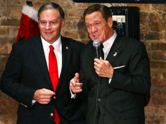 "FILE – In this Dec. 6, 2016, file photo, actor, comedian and radio host Joe Piscopo, right, and New Jersey Assembly Republican Leader Jon Bramnick, R-Union, N.J., left, participate in a comedy fundraiser for the Boys & Girls Club of America at the Stress Factory Comedy Club in New Brunswick, N.J. Piscopo is giving up on running as a Republican for governor to succeed Chris Christie, but the former ""Saturday Night Live"" cast member is ""more serious"" than ever about running as an independent, he said in an interview with The Associated Press."