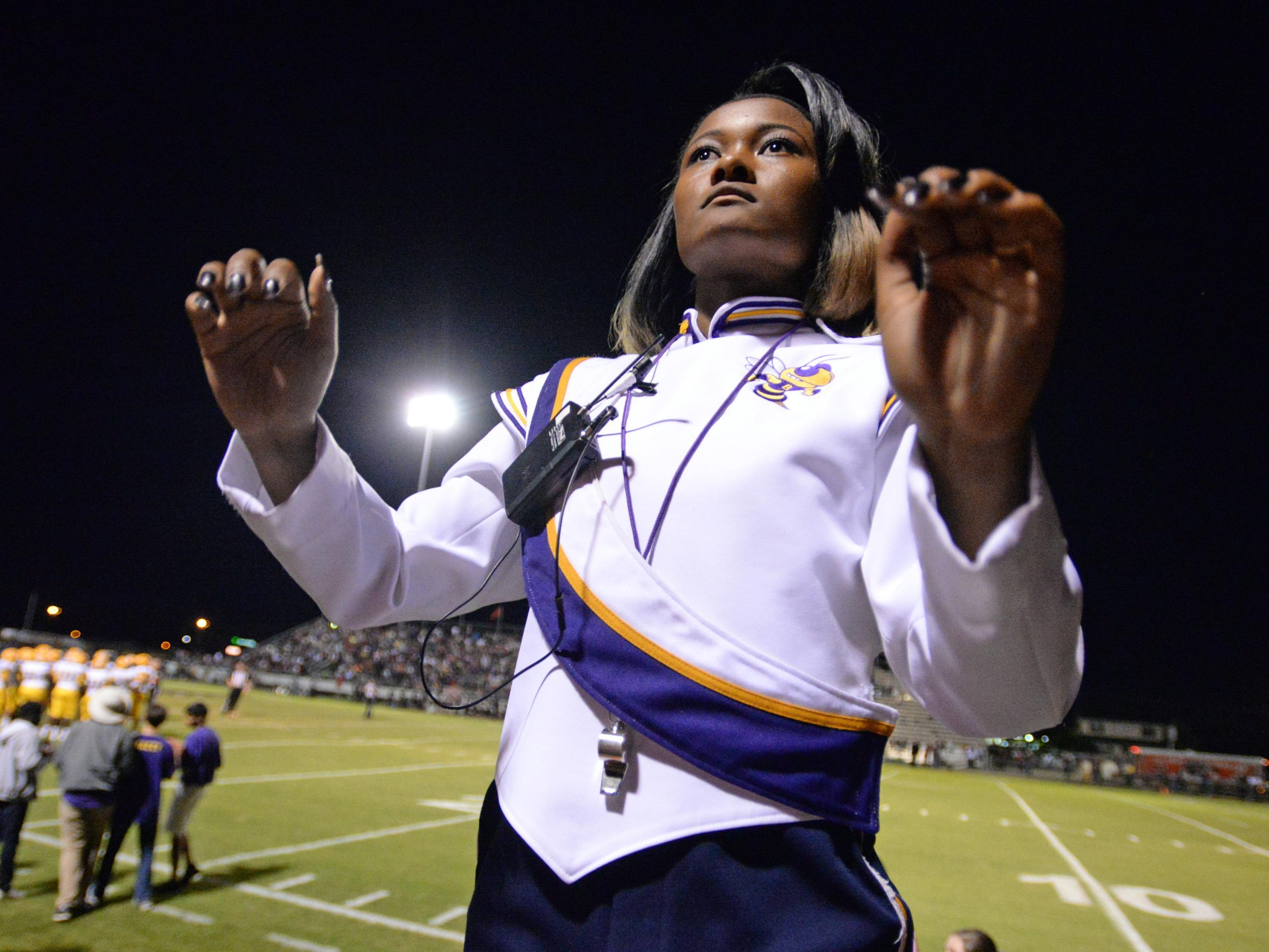 Antionette Van leads the C.E. Byrd marching band rally their team during a recent road game against Parkway.