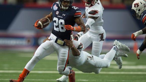 Auburn defensive back Tray Matthews (28) runs downfield