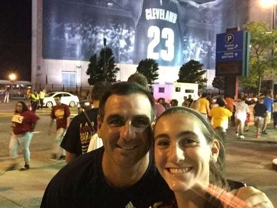 Fort Myers resident and Cavaliers season-ticket holder Dan Mills with one of his twin daughters Audrey in Cleveland.
