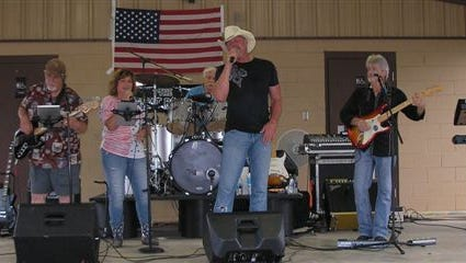 Country singer Trace Adkins make a surprise appearance at the Sarepta July 4 celebration and sang with the  Backbeat Boogie Band.