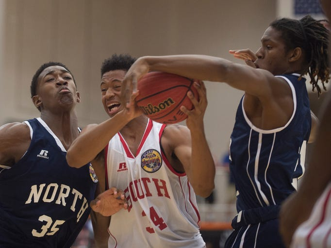 Prattville's Azariah Seay (34) goes up as Homewood's