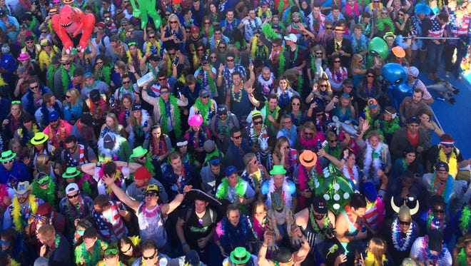 Whatever USA revelers take in the music, and beer, in Crested Butte, Colo.