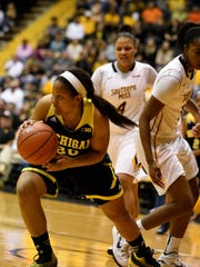 Michigan guard Danielle Williams reels in a rebound versus Southern Mississippi on Sunday. U-M led by as many as 19 points