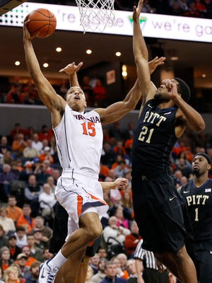 Virginia Cavaliers guard Malcolm Brogdon (15) shoots the ball as Pittsburgh Panthers forward Sheldon Jeter (21) defends in the second half at John Paul Jones Arena. The Cavaliers won 61-49.