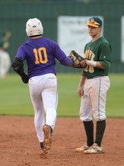Capt Shreve's Reid DuBois acknowledges Zavier Moore of Byrd after Moore hit his second homerun on the night.