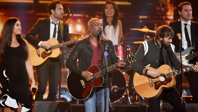 "Members of Lady Antebellum perform ""Hold My Hand"" with Darius Rucker during the CMA Awards at Bridgestone Arena on Wednesday, Nov. 8. 2017."