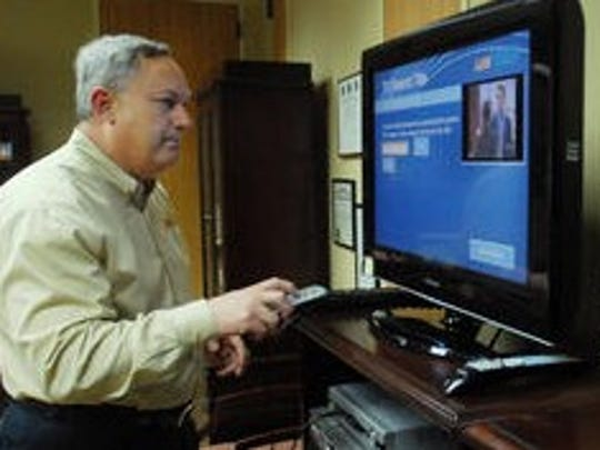 LUS Director Terry Huval demonstrates the LUS Fiber video system in this Advertiser file photo.
