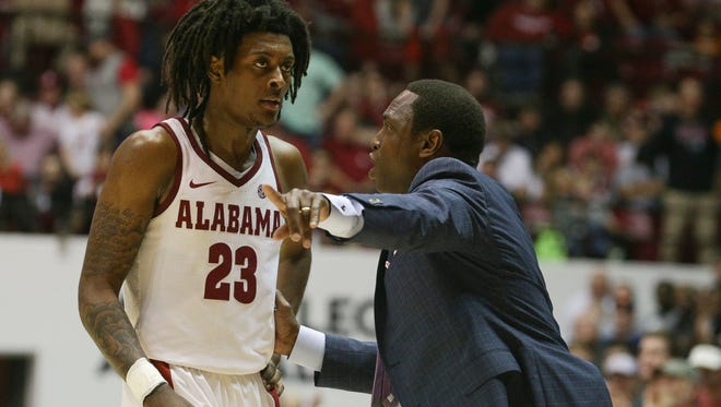 Feb 10, 2018; Tuscaloosa, AL, USA; Alabama Crimson Tide head coach Avery Johnson talks to guard John Petty (23) during the second half against the Tennessee Volunteers at Coleman Coliseum. Mandatory Credit: Marvin Gentry-USA TODAY Sports