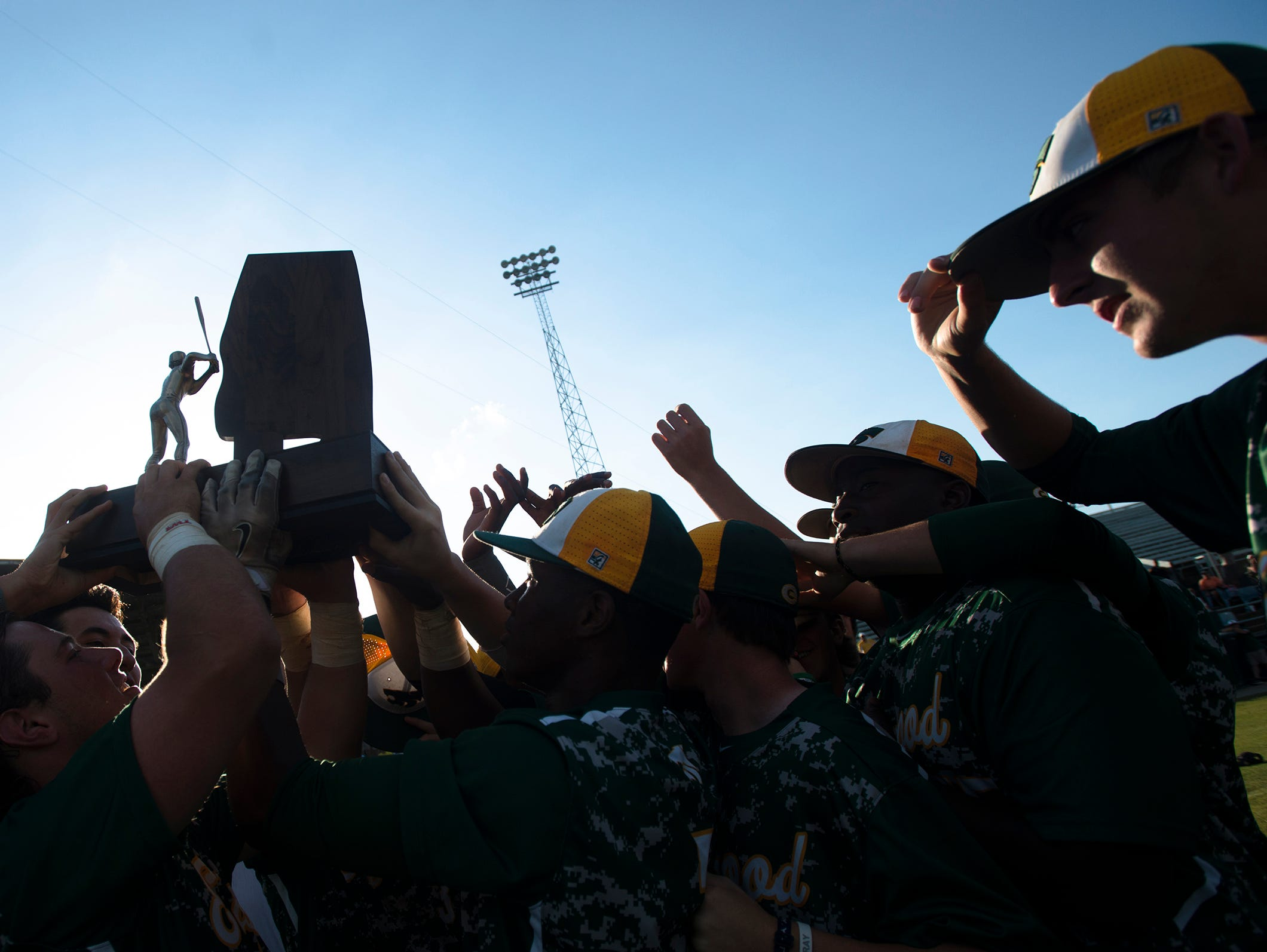 Edgewood's team holds up the AISA Class AA State Baseball Championship Series Game 3 on Tuesday, May 5, 2015, at Paterson Field in Montgomery, Ala. Edgewood defeated Macon East 18-5 to win their seventh strait State Championship.