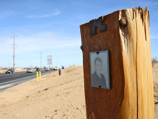 In Yucca Valley a vandalized cross with a picture of deceased Johannes Gysen overlooks the deadliest intersection on Hwy 62 at La Contenta Rd/Yucca Mesa Rd.