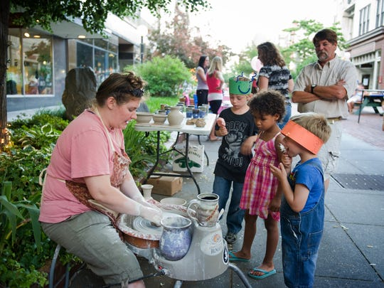 Children watch a potter at work during one of Salisbury's 3rd Friday events.