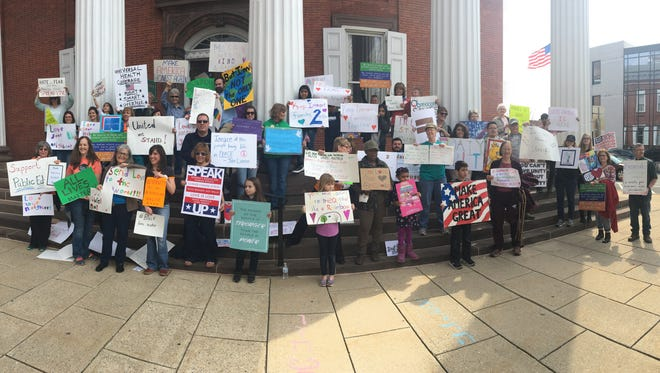 Participants hold their signs at the Unity Gathering the morning of March 25 in downtown Chambersburg. The event was hosted by Franklin County Coalition for Progress.